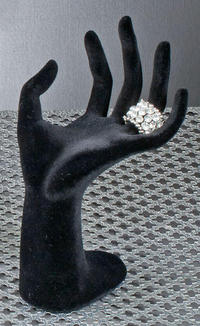 Black Velour Jewelry Hand (Bent back Black Velour Jewelry Hand is made of resin and covered in lovely black velour. Will surely add pizzazz to any display of fine jewelry. Life-like form is great for holding rings and bracelets and can even hold and display necklaces in the palm.)