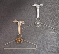 Decorative Gold & Silver Coat Hangers (These are not your ordinary hangers. The Decorative Gold & Silver Coat Hangers are perfect for hanging outside the closet. Add a fun delightful touch to any closet, room or store display. Hang scarves, clothes, coats or use just for looks.<br /><br />Gold Coat Hanger is has a beautiful silver gold finish. Features a gold beaded flower with a clear bead accent.<br /><br />Silver Coat Hanger is has a beautiful silver foil finish. Features a silver beaded flower with a clear bead accent.)