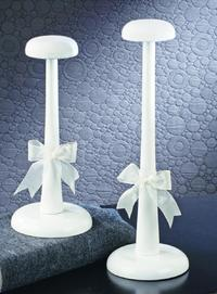 White Wood Hat Stands (White elegant hat stands will display any hat with style. Hat Stands are made of wood with a white-painted finish. They are dressed with a sheer ribbon tied at the base.)